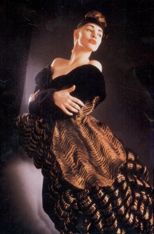 Garment - Photograph of a woman in a black and brown dress by Sue Chowles