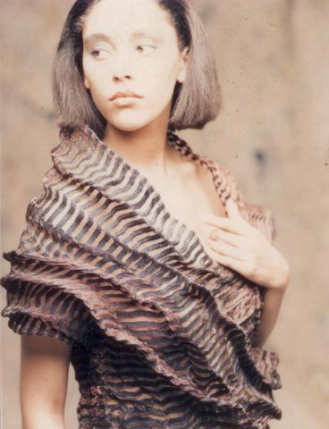 Garment - Photograph of a woman in a striped sculpural shawl by Sue Chowles