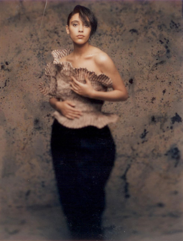 Garment - Photograph of a woman in a beige sculptural top by Sue Chowles