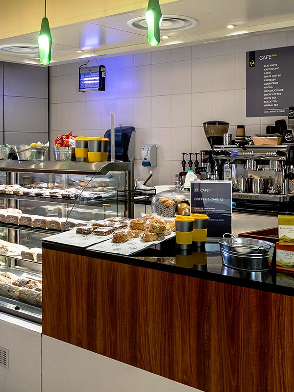 Cafe NUA at Norwich University of the Arts in the St Andrews House building showing cakes, pastries and various food.