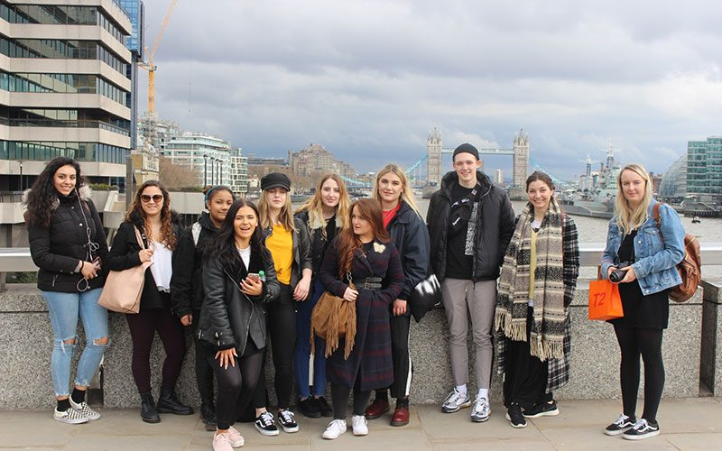 Interior Design students at Norwich University of the Arts standing on a bridge in London