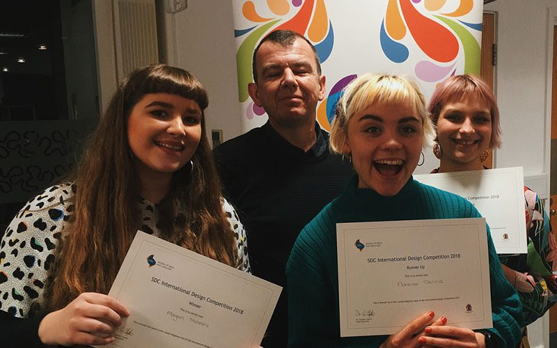 Two Norwich University of the Arts students hold awards won at the Society of Dyers and Colourists.