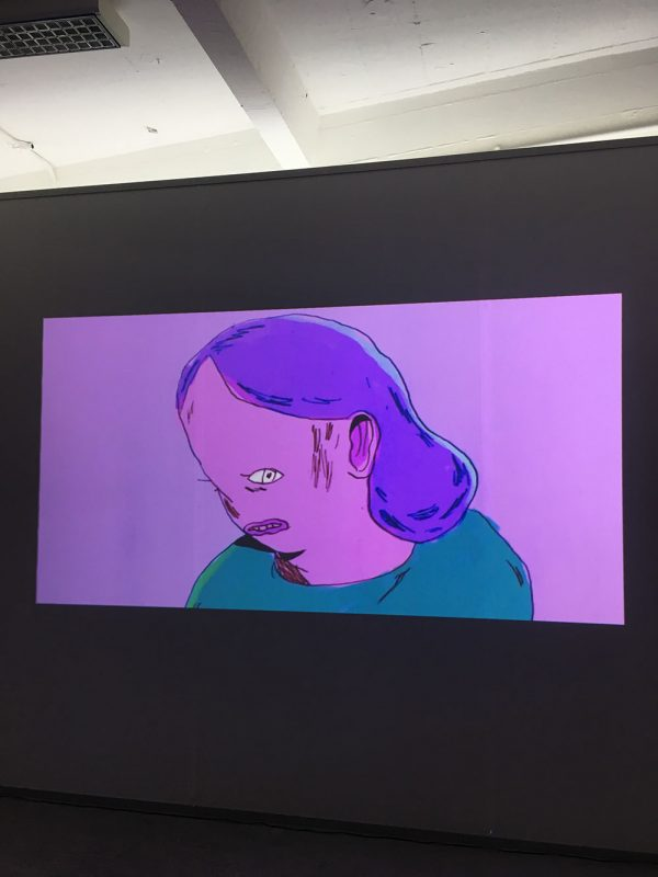 - A video screen showing a purple back drop with a person on a screen in purple