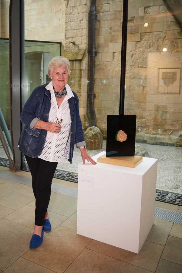 Averil Cooper, BA Fine Art - Averil Cooper, Fine Art winner in the Bishop's Art Prize standing by her work in Norwich Cathedral