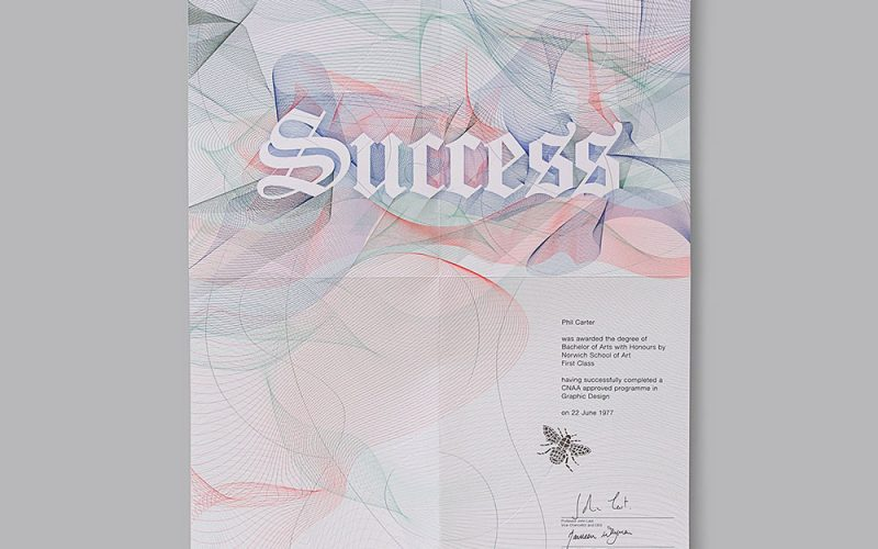 Norwich University of the Arts Degree Show certificate by Phil Carter showing the word 'success'