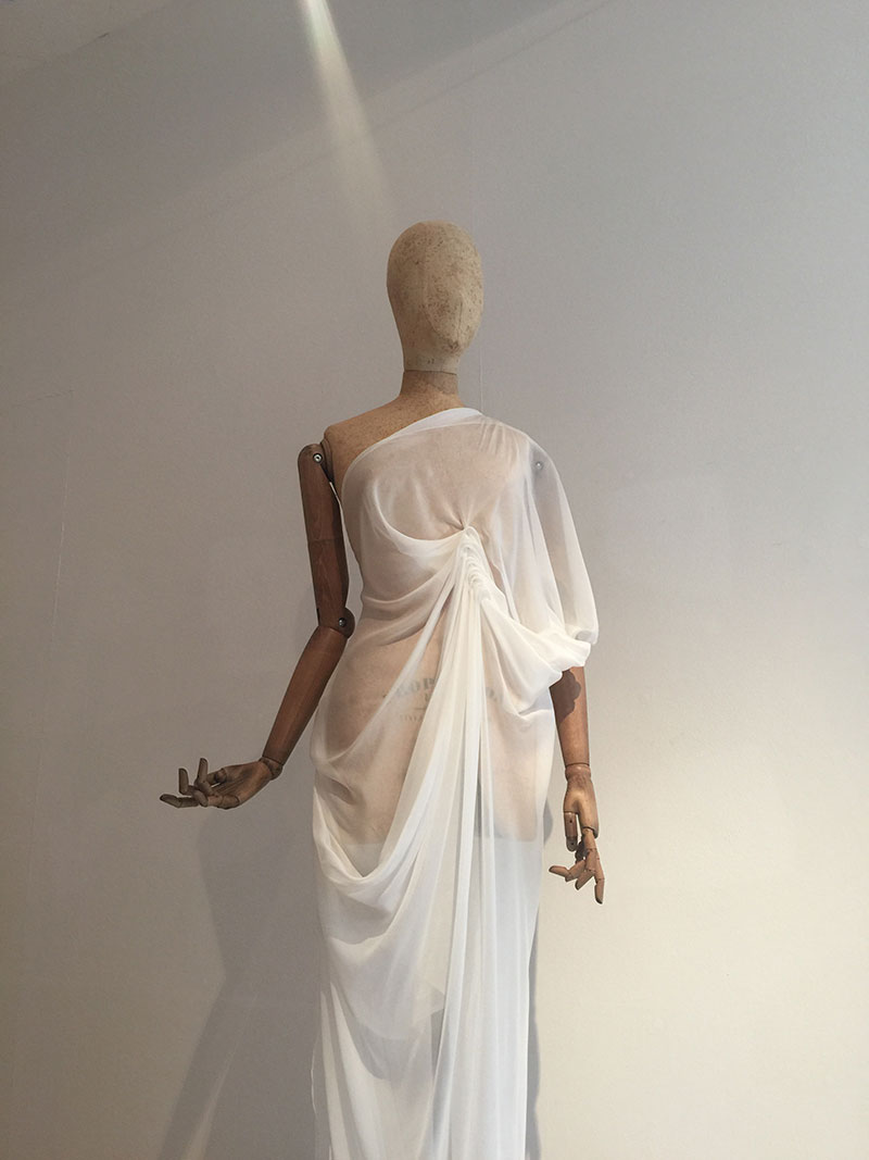 Mannequin in the MA Degree Show draped in white fabric designed by Elizabeth Elliot at Norwich University of the Arts