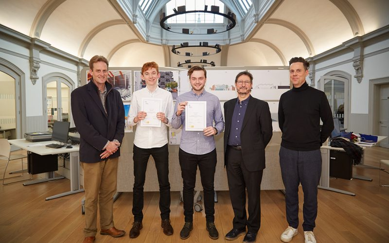 Architecture students Declan Allison and David Wiley receiving their certificates for the Feilden+Mawson Scholarship with Philip Bodie, John Last and Simon England
