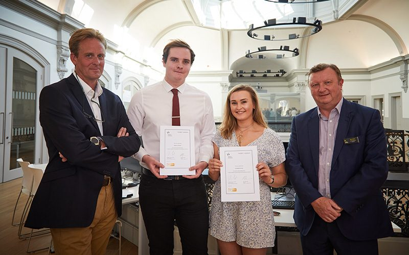 Philip Bodie and Neil Powell presenting certificates to Evangeline House and Stephen Johnson for Feilden+Mawson Scholarship