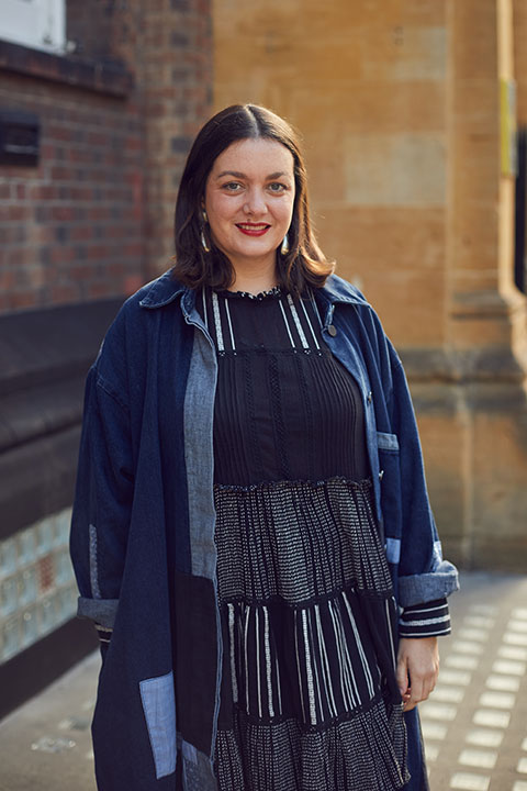 Susie Lloyd, BA Fashion Communication and Promotion Lecturer standing outside St Georges Building, Norwich University of the Arts