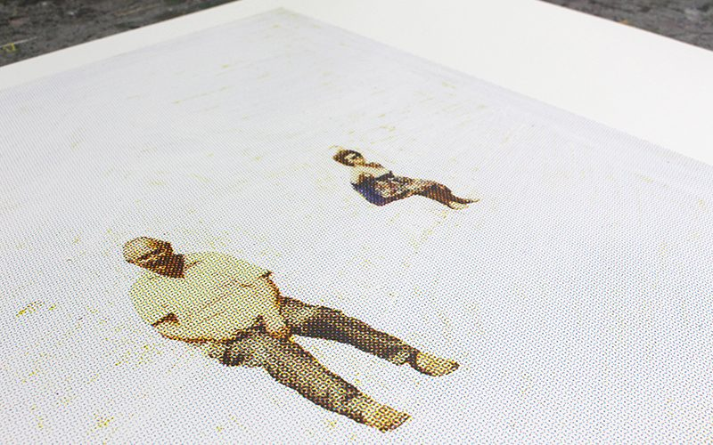 Billy Parkin print laid flat depicting an old man stood near a woman in a bathing suit