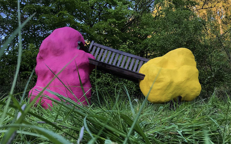 Naomi Kirk-Smith sculpture of wooden bench held up by two uneven bright pink and yellow blobs