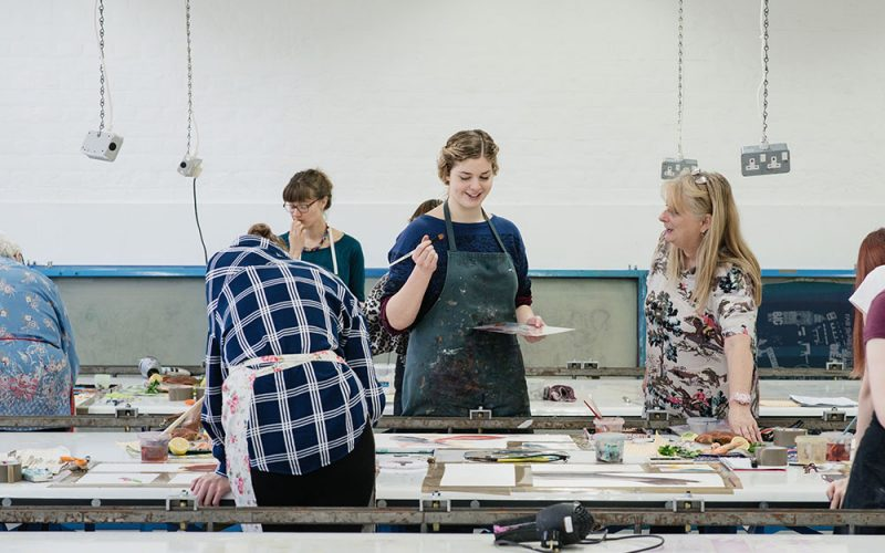 Students in the Textiles studio at Norwich University of the Arts working on textiles work