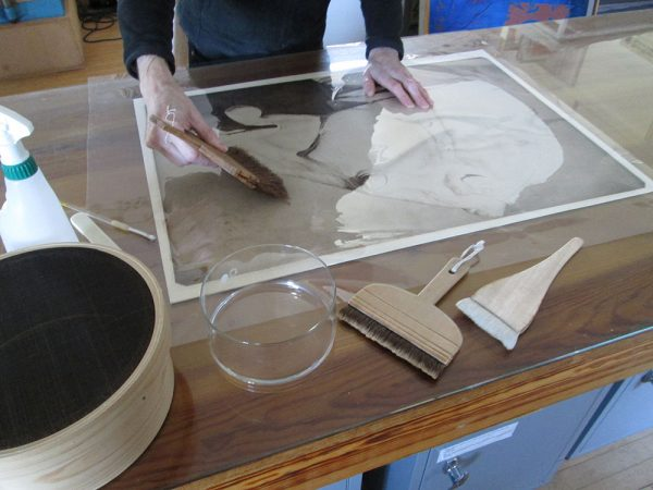 - Restorer working on Sir Alfred Munnings horse head restoration