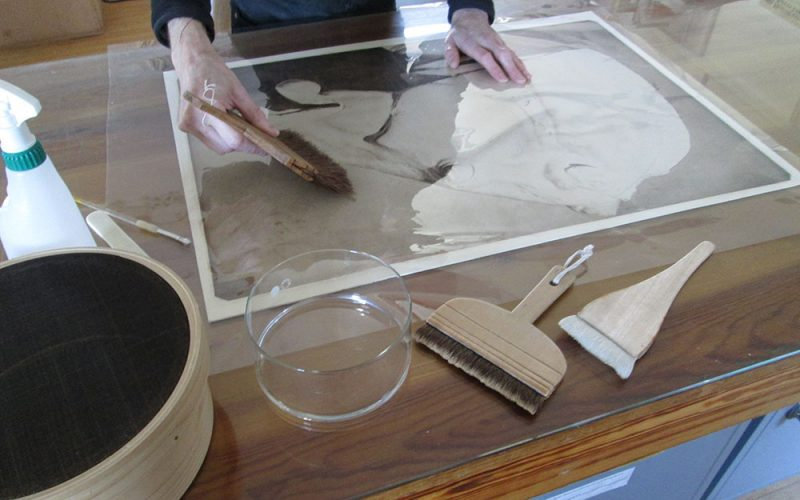 Restorer working on Sir Alfred Munnings horse head restoration