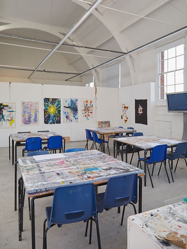 Fine Art Painting Studio at Norwich University of the Arts, showing a creative painting space including chairs and easels by a window