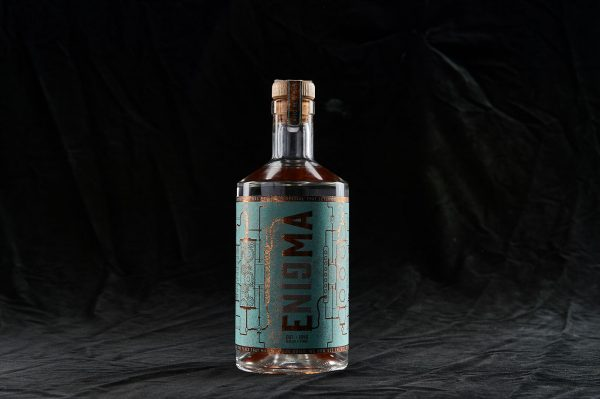 Tom Baines - Designed gin bottle with the words 'Enigma' on by BA Graphic Design graduate Tom Baines