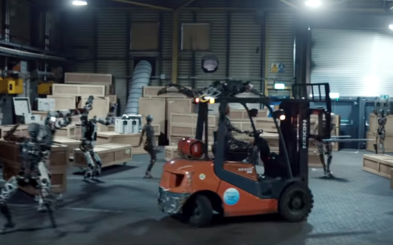 Still from the Chemical Brothers 'Free Yourself' video with a robot driving a forklift truck