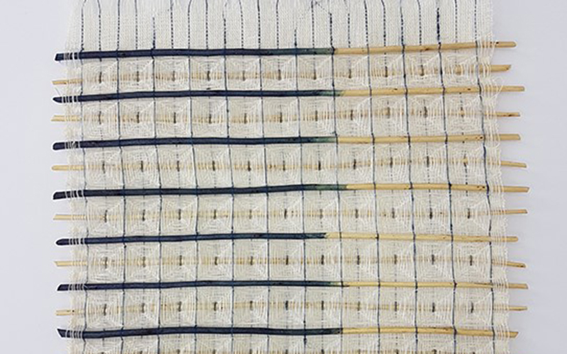 Textile Design piece by Lizzie Kimbley showing many white squares separated by dark blue lines