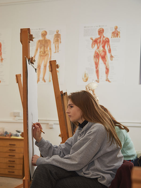 Student working in the Alfred Munnings Drawing Studio at Norwich University of the Arts