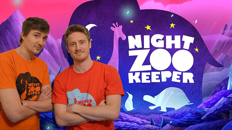 Creators of Night Zoo Keeper stand in front of graphics of Night Zoo Keeper