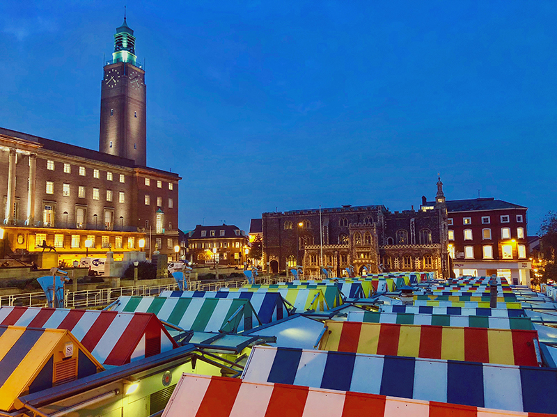 The colourful roofs of Norwich market at dusk