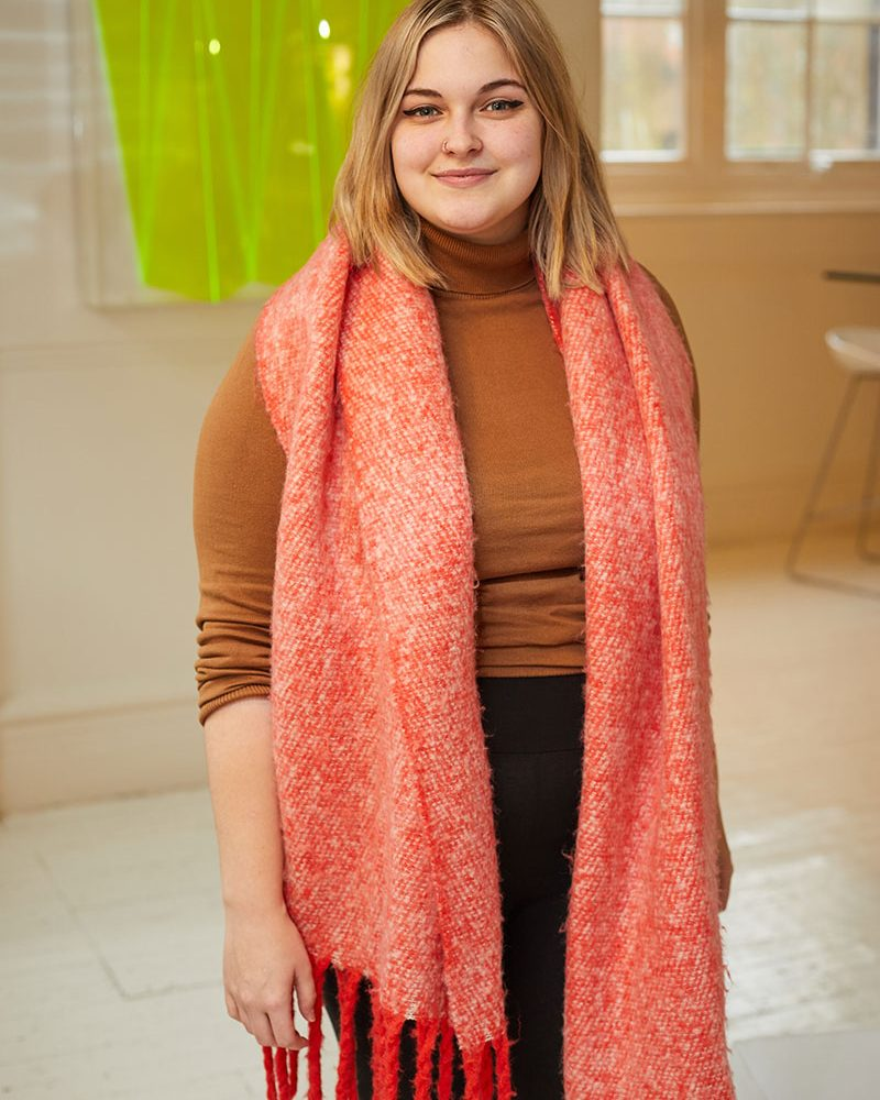 Daisy Morgan, BA Animation graduate from Norwich University of the Arts stands on campus