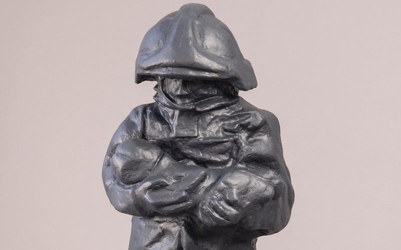 Paul Digby sculpture of a fireperson holding a baby