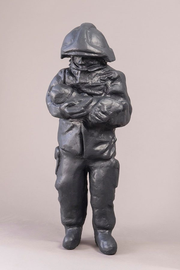 - Paul Digby sculpture of a fireperson holding a baby