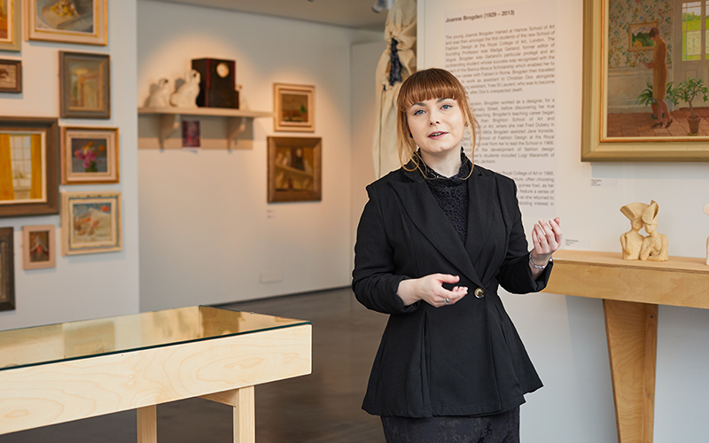 Photo of student Robyn Bailey looking at the camera in NUA's East Gallery