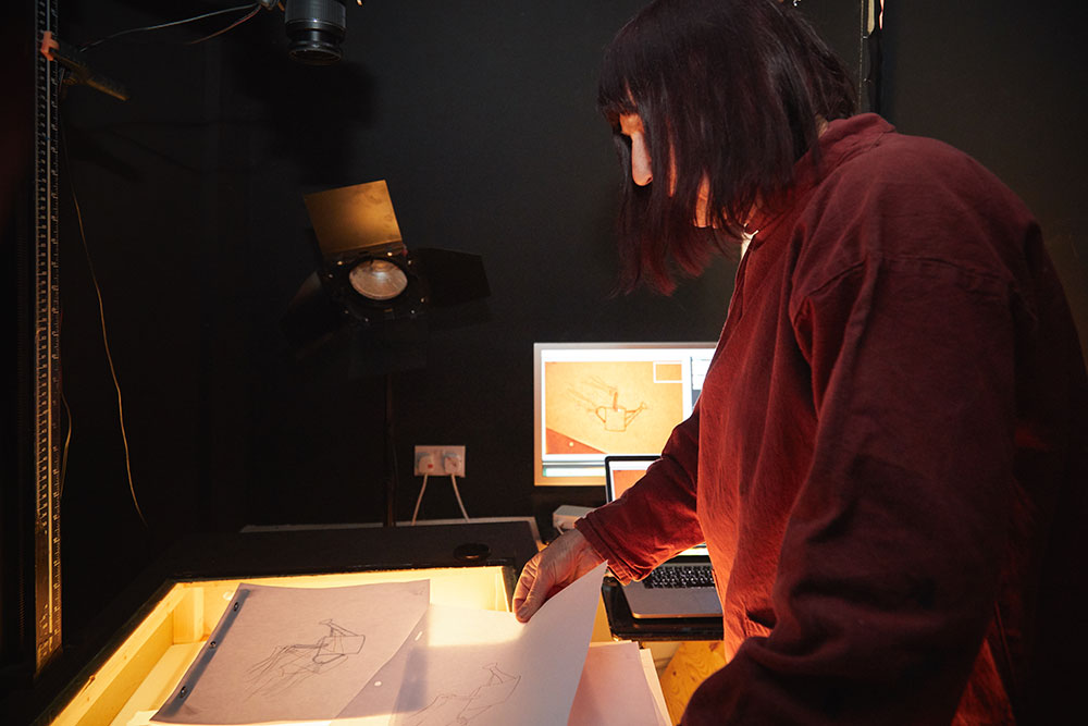 Suzie Hanna working in her animation studio