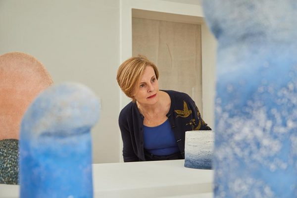 MA Subject Leader for Curation Caroline Fisher - Caroline Fisher Subject Leader for MA Curation at Norwich University of the Arts in her gallery looking at blue art