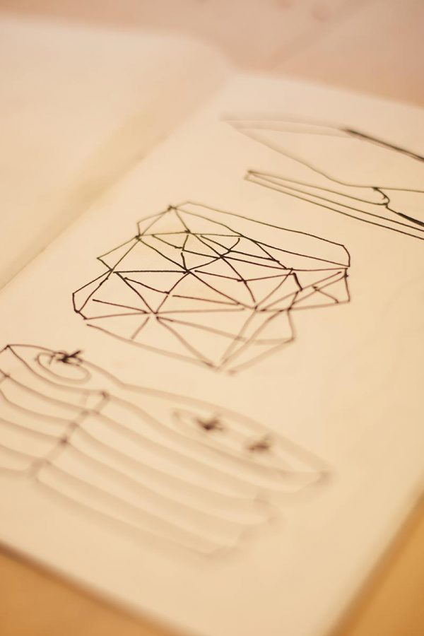 In the studio with Desmond Brett - Desmond Brett sketches of his sculptural work in a book