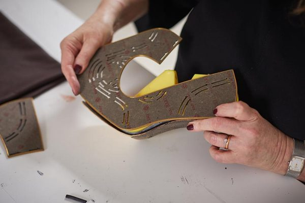 In the studio with MA Leader, Marie Brennan - Marie Brennan, MA Leader at Norwich University of the Arts holding her home-made shoe designs