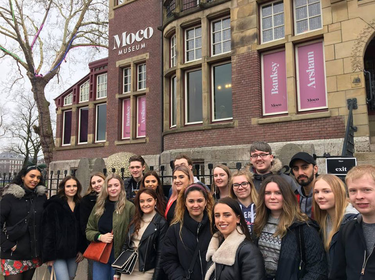 BA Interior Design degree course students stand outside the Moco Museum in Amsterdam on a course trip