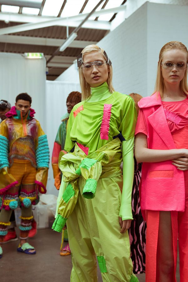 Annie Read  - BA Fashion student work modelled at Graduate Fashion Week, work by Annie Read, photo by Kerry Curl of a bright green outfit