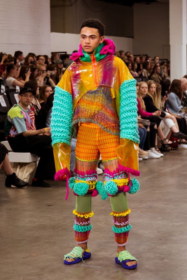 Phoebe Constable - A brightly coloured outfit made from bio-plastics by Phoebe Constable of BA Fashion at Norwich University of the Arts, modelled on a catwalk at Graduate Fashion Week