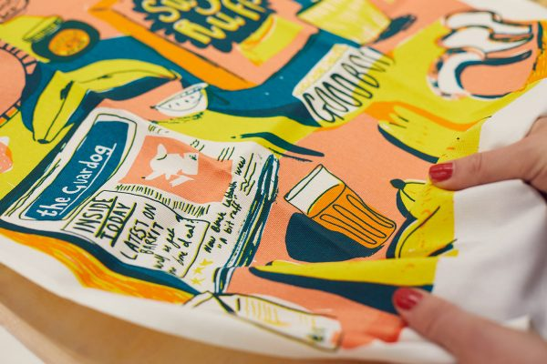 Florence Poppy Dennis - Close up of a tea towel designed by BA Textile Design Florence Poppy Dennis, showing dogs