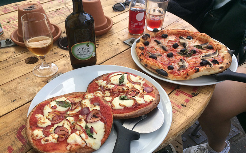 Pizzas outside the Greengrocers