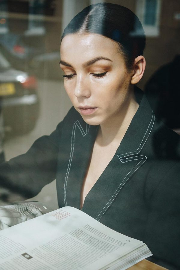 Gabrielle Hopley - Woman modelling for BA Fashion Communication and Promotion student Gabrielle Hopley looking at a book