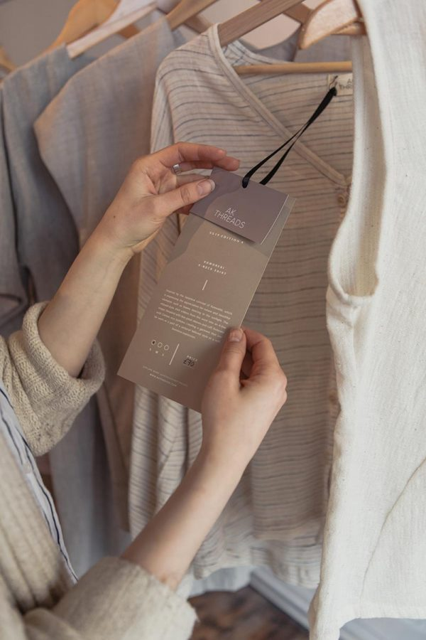 Marta Zaremba - Person holding a tag of a clothing designed by BA Fashion Communication and Promotion student Marta Zaremba