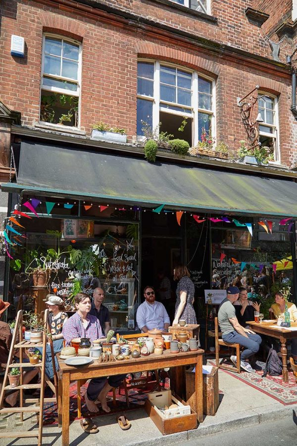 Norwich Lanes Fair - People sat outside the Bicycle Shop cafe eating and drinking at the Norwich Lanes Fair