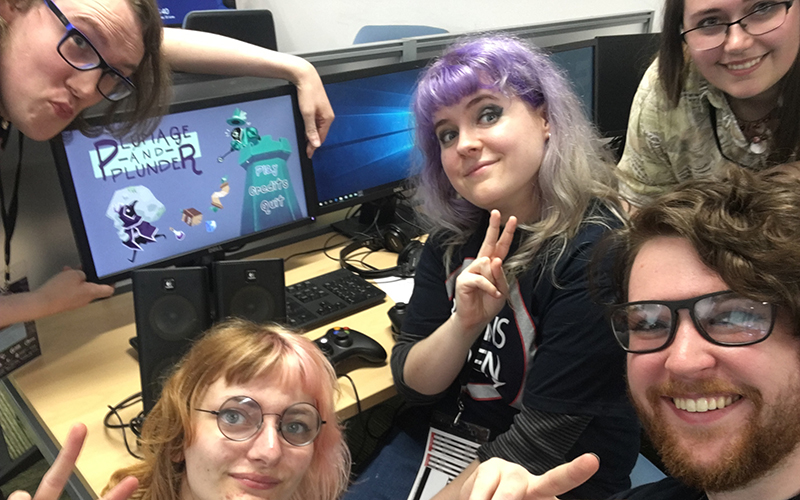 BA Games Art and Design students at the Brains Eden competition in front of a computer