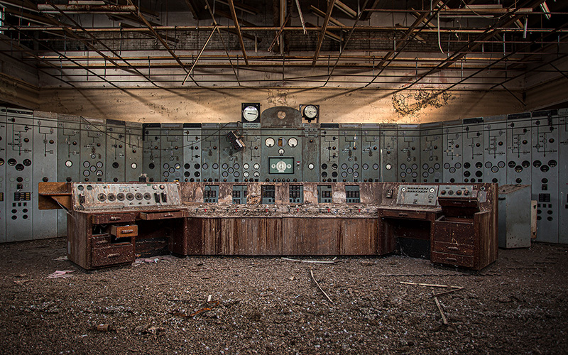 Photo showing an abandoned power station desk in low sunlight