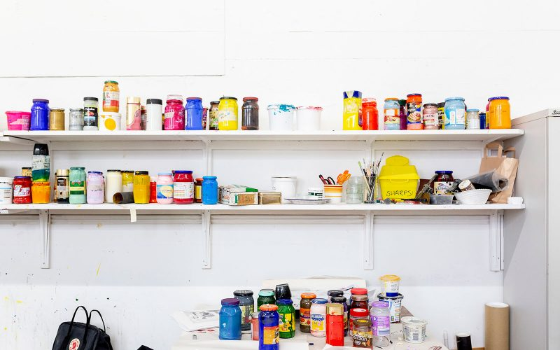 Colourful messy paint pots in the Norwich University of the Arts print studio