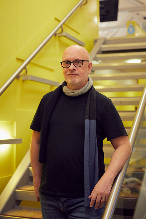 Animation and Visual Effects Lecturer Steve Abrahart at Norwich University of the Arts standing on the staircase
