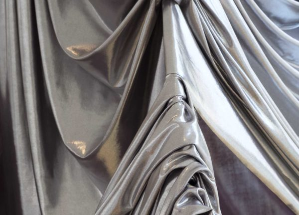 Emily Cannell, MA Fashion - Close up of silver fabric draped over a metal object