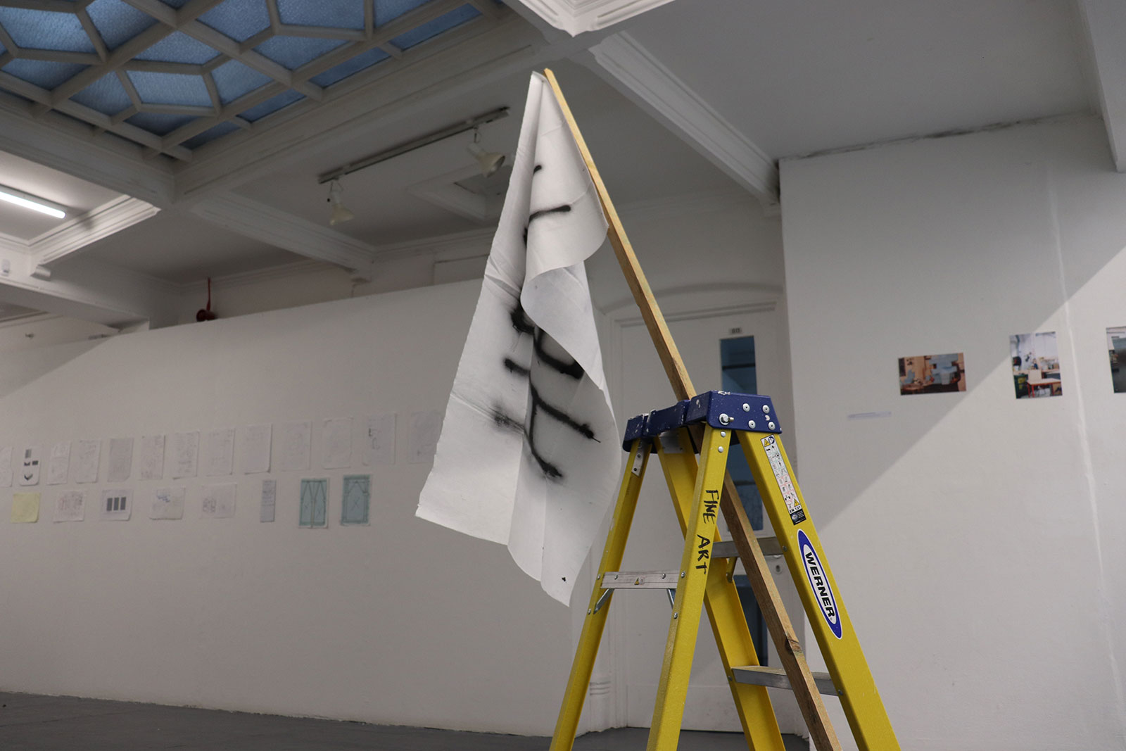 Maddie Exton, BA Fine Art student creates art work at Norwich University of the Arts, a ladder holding up a white flag