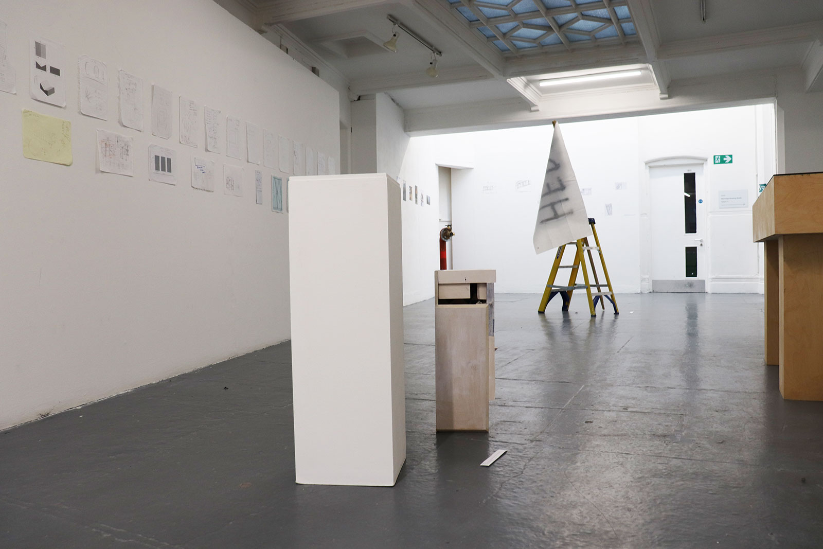 Fine Art space at Norwich University of the Arts showing plinths and a ladder