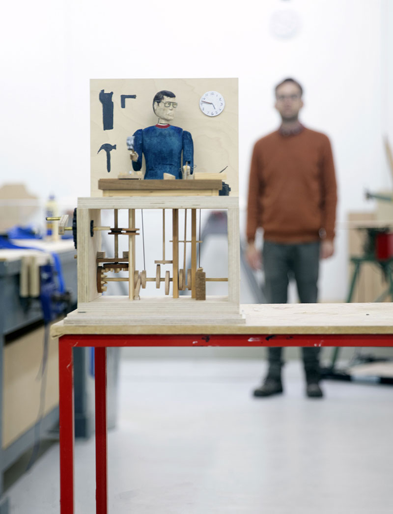 3D technician at Norwich University of the Arts standing behind a table with a piece of art in front
