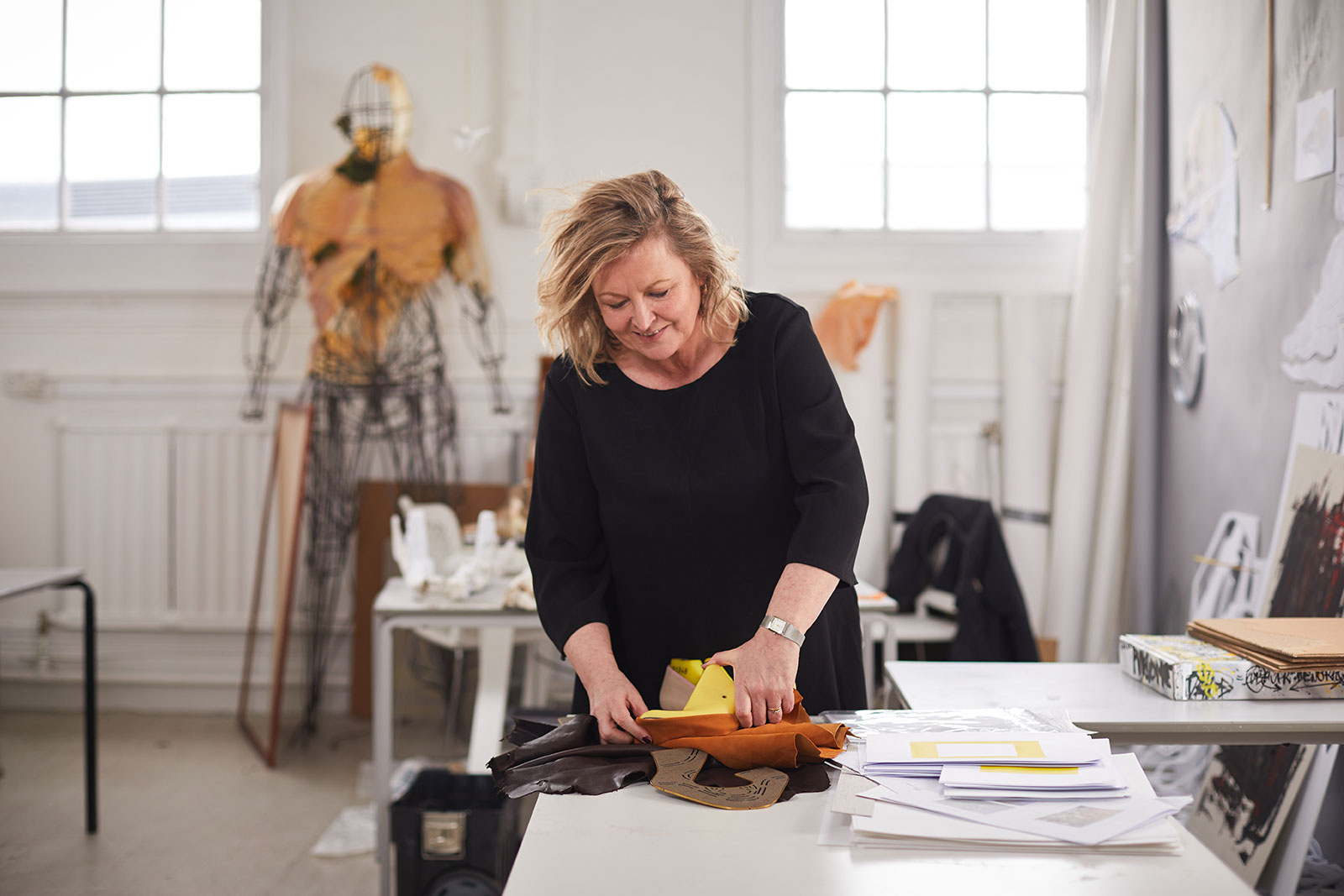 Marie Brennan works on her shoemaking business in the NUA MA Fine Art studio in front of art